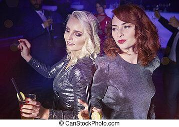 Women having a fun at night club