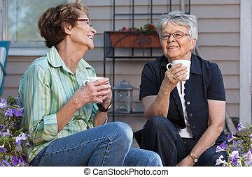 Women having cup of tea - Senior female friends enjoying cup...