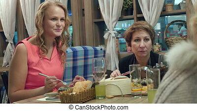 Women having dinner at the restaurant