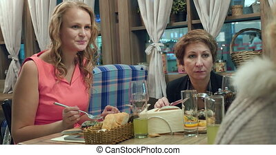 Women having dinner at the restaurant