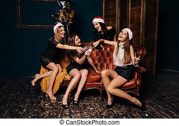 Women having fun at Christmas party