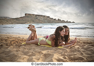 Women having fun on the beach