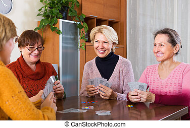 Women having fun with cards