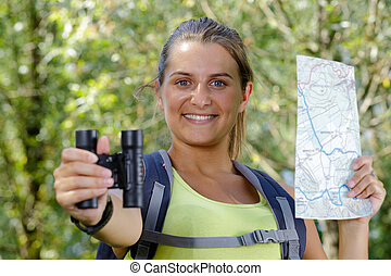 women hiker look binoculars in wilderness area