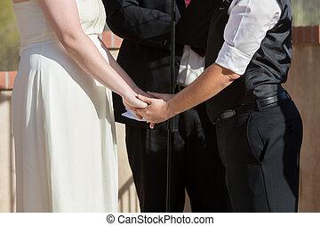 Women Holding Hands in Wedding Ceremony