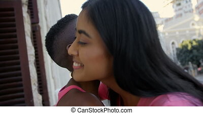 Women hugging each other in balcony at home 4k