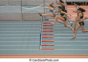 women hurdlers race