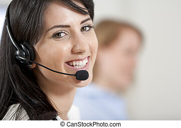 Women in a busy call centre - Two colleagues working in a...