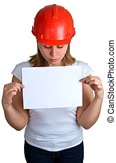 women in a red helmet holding a sheet of paper