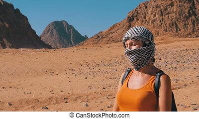 Women in an Arab Headdress in Desert of Egypt. Portrait of a...