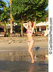 Women in bikini standing