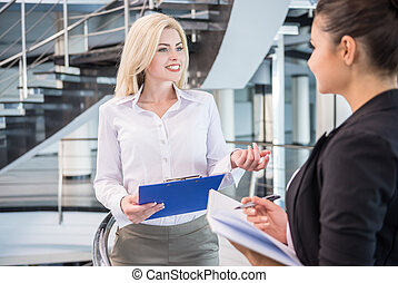 Women in business - Two beautiful female business partners...