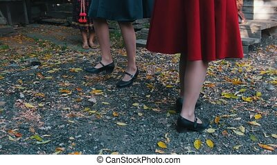 Women in colorful skirts dancing by the music and having fun...