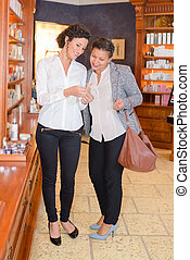 Women in cosmetics store