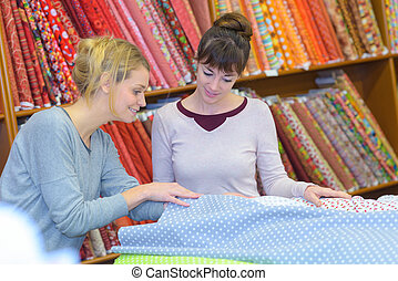 Women in fabric shop