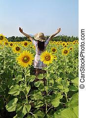 women in field of sunflowers