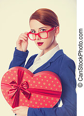 Women in glasses with gift