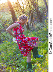 Women in green wellington shoes.