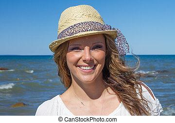 Women in Hat on the Beach