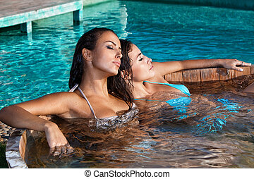 women in jacuzzi