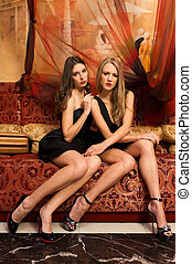 Women in orient interior - Two beautiful women are sitting...