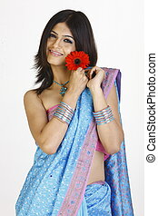women in sari with daisy flowers