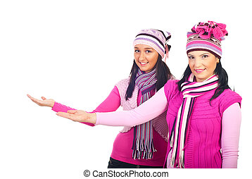 Women in woolen pink clothes making presentation - Two...