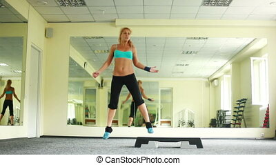 Women is doing exercises with step - Sport indoors