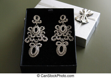 large decorative earrings in a box