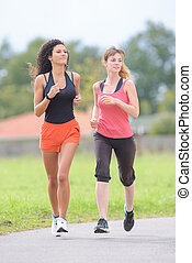 women jogging in the park