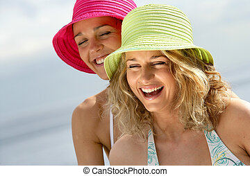Women laughing at the beach