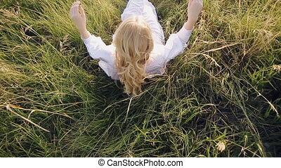 women lay on green grass outdoors
