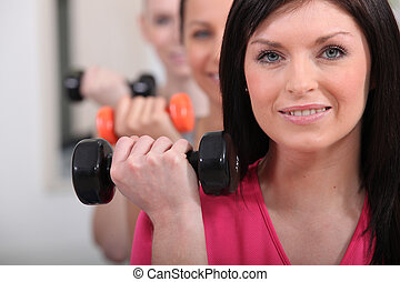 Women lifting dumbbells