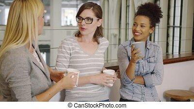 Women listening to their colleague