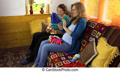 women look knitted hat - granny and pregnant woman look...