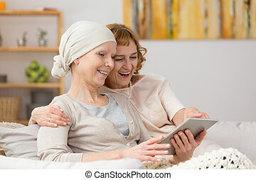 Women looking at a tablet