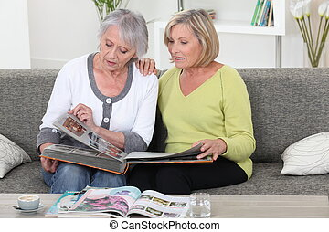 Women looking at photo album