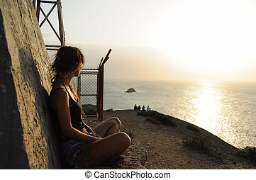 Women looking at Sunset over the Oc