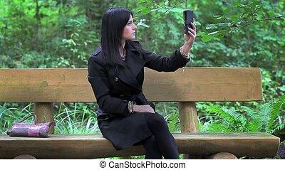 Women make selfie on the bench