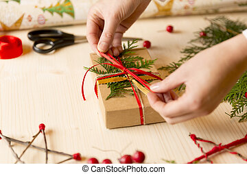 Women making Christmas gifts at home by hand before holidays