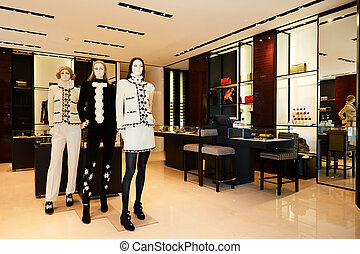 Women mannequins in luxury clothes shop