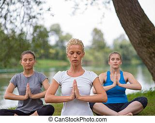 women meditating and doing yoga exercise