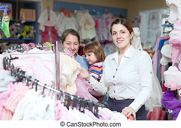 women of three generations chooses clothes