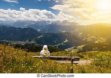 Women on a bench in Italian Alps