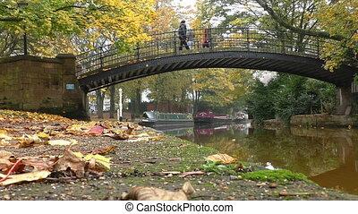 Women on bridge over canal autumn