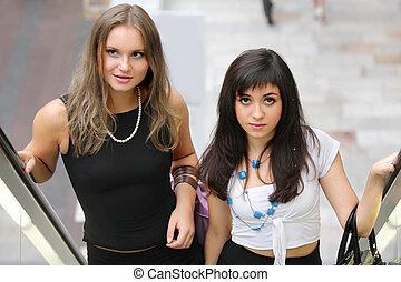 Women on escalator