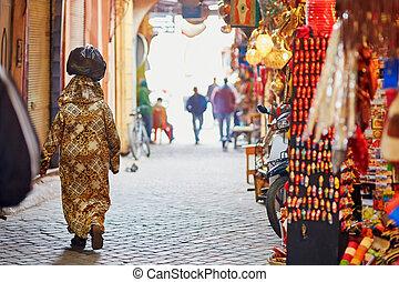 Women on Moroccan market (souk) in Marrakech, Morocco
