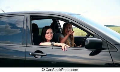 Women on roadtrip stopping in countryside