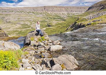 Women on the rock - Iceland.