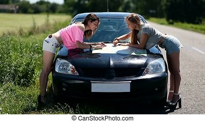 women on vacation looking at map for directions